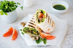 Burritos wraps with mushrooms and vegetables,  Mexican food.