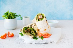 Burritos wraps with mushrooms and vegetables-traditional Mexican food. Vegetarian food.