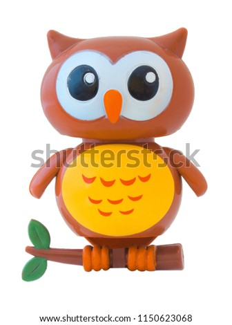 Burrowing owl on small twig, plastic toy, isolated on white background. Howlet made of plastic, plaything for little kids. Night owl doll. Nighthawk dummy. Small plastic owl on white bg.   - Shutterstock ID 1150623068