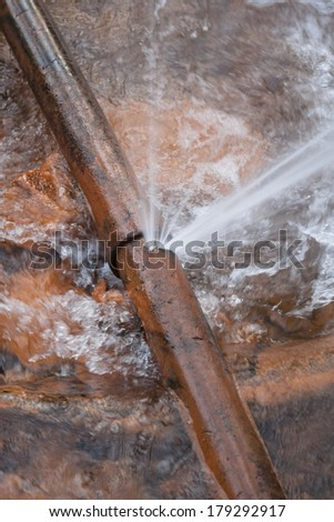 burst water pipe  cast iron in stream