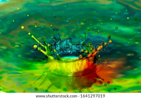 Bursts of multi-colored bright colors of paint in the form of crowns and colorful splashes