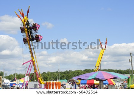 BURTON, OH - SEPT 5: Riders suspended at the top of a steep drop ride at the 188th annual Great Geauga County Fair on September 5, 2010 in Burton, Ohio.