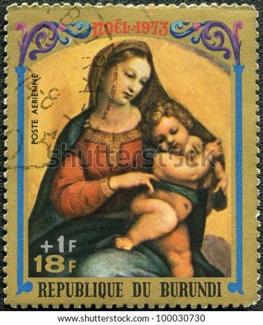 BURUNDI - CIRCA 1973: A stamp printed by Burundi shows Virgin and Child by Raphael, series Christmas, circa 1973