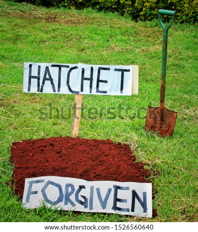 bury the hatchet - to forgive. this picture can be used to illustrate  #1526560640