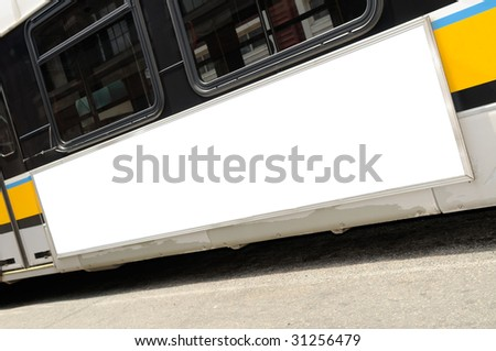 Bus advertising. Close-up of blank billboard on bus side. - stock photo