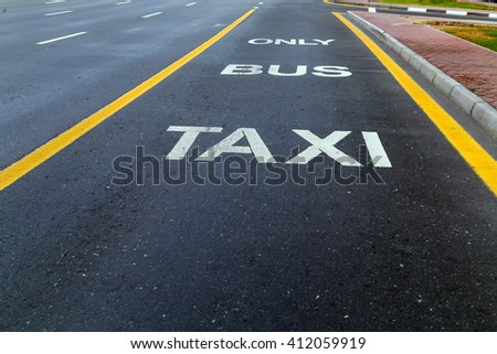 Bus and Taxi sign painted on street #412059919