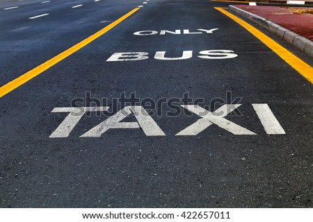 Bus and Taxi sign painted on street outdoors #422657011
