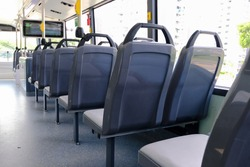 Bus interior: back view of seats on empty double decker bus. Blank advertising space; for mockup display; seat sticker wrap.