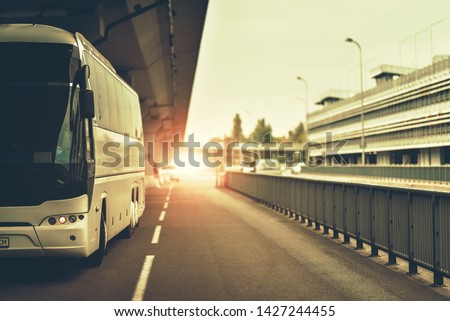 bus of tourist company which making transfers from airport to city #1427244455