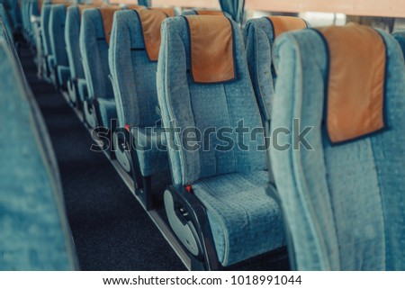 Bus passenger seats abstract wallpaper. Copy space.