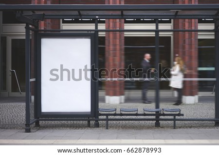 Bus station billboard with blank copy space screen for your advertising text message or promotional content, empty mock up Lightbox for information, stop shelter clear poster in urban city scene #662878993