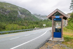 Bus stop in a mountainous setting in Norway.