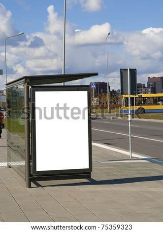 Bus stop on a high-speed  highway near to a city. Solar autumn day.