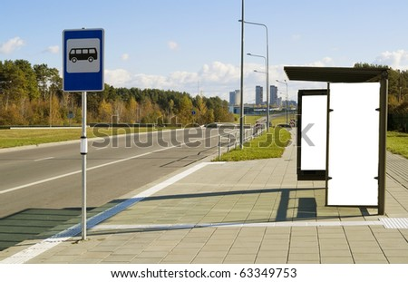Bus stop on a high-speed  highway near to a mega city. Solar autumn day.