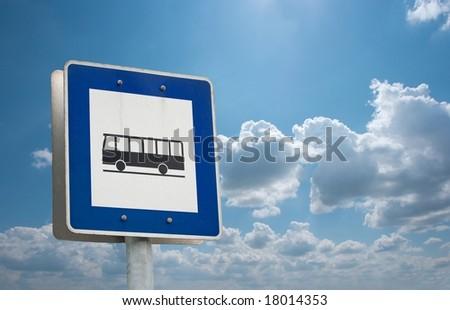 Bus stop sign against blue sky