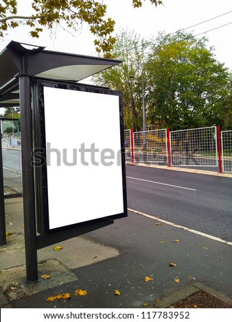 Bus stop with a blank bilboard