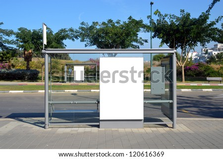Bus stop with a white blank sign