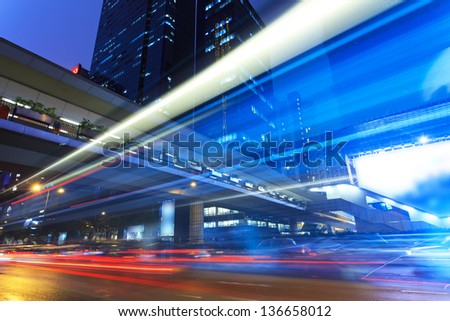 bus through street with blur light