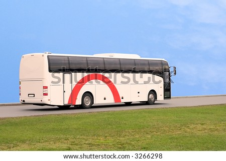 Bus travel at speed of a backgound of blue sky - stock photo