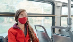 Bus travel during coronavirus. Asian woman commuter wearing mask riding public transport commuting as prevention. Safety in city outdoor indoor people lifestyle.