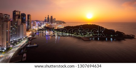 Busan beach view in Busan city day to night picture with sunrise sky and full moon, South Korea, this picture can use for tavel, Busa, South Korea and  city concept