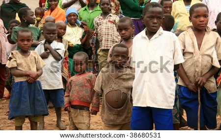 BUSANZA, KISORO, UGANDA  - NOV 2 : Refugees from Democratic Republic of Congo at the border village of Busanza November 2, 2008 in Kisoro, Uganda. - stock photo