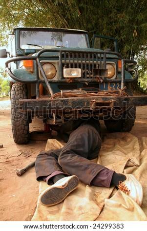 Bush Mechanic, working on old truck