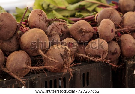 Bushel of red beets grown locally and clustered in a farmers market