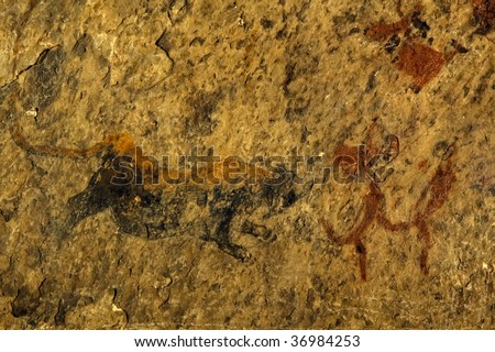 Bushman paintings, Lion  and bushman running, Eastern Cape, South Africa