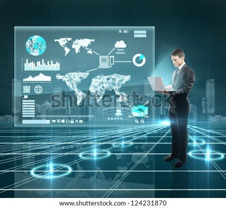businesman standing in interface world with notebook