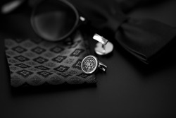Business accessories. Luxury Men's cufflinks with watch, breastplate and sunglasses close up.