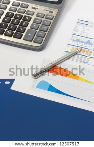 Business accessories on a background of diagrams and blue file