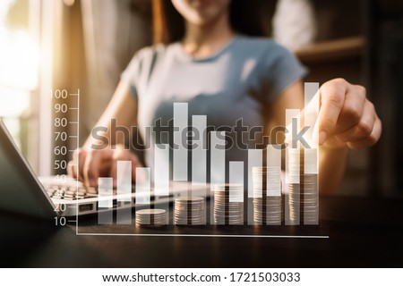 Business accountant working on desk using mobile phone and calculator to calculate budget concept finance and accounting in morning light  Foto stock ©