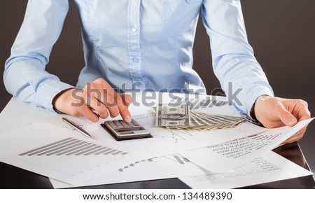 Business accountant working with documents and money