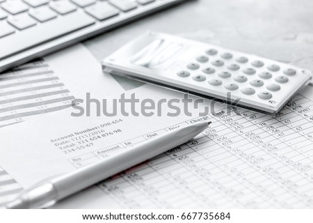business accounter work with taxes and calculator on white office desk