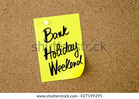 Business Acronym  BHW Bank Holiday Weekend written on yellow paper note pinned on cork board with white thumbtack, copy space available #427599295