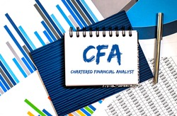 Business Acronym CFA - Chartered Financial Analyst. Text on the notebook with chart.Conceptual image