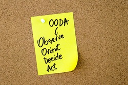 Business Acronym OODA as Observe Orient Decide Act written on yellow paper note pinned on cork board with white thumbtack, copy space available