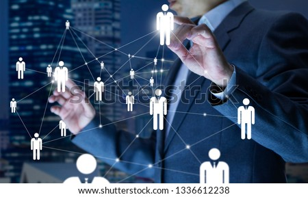 Business administrator in action of manpower or human resource planning or business organisation on a virtual dashboard.
