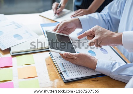 Business adviser analyzing financial figures denoting the progress Internal Revenue Service checking document. Audit concept #1167287365