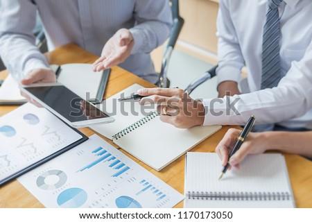 Business adviser analyzing financial figures denoting the progress Internal Revenue Service checking document. Audit concept #1170173050