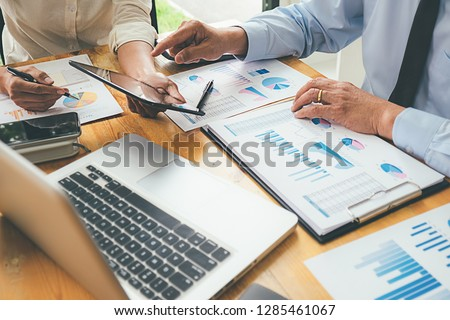 Business advisor analyzing financial figures denoting the progress Internal Revenue Service checking document. Audit concept #1285461067