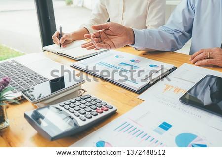 Business advisor analyzing financial figures denoting the progress Internal Revenue Service checking document. Audit concept Stock foto ©