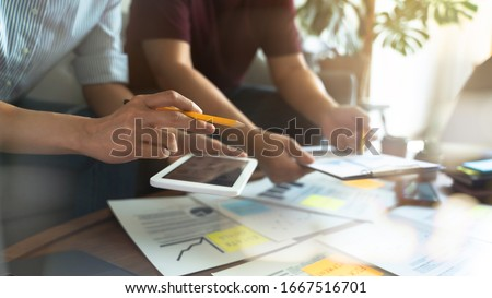 Business advisor Financial team meeting about economy analysis.