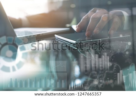 Business analysis and modern technology concept. Businessman, analyzing business data on digital tablet and laptop computer on office desk, computer dashboard, stock market report on virtual screen #1247665357