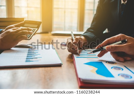 Business Analysis and Strategy. Businessman work with calculator on table in office work with paper graph chart business marketing plan analysis #1160238244