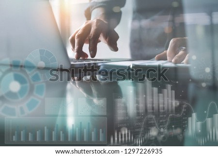 Business analysis and technology concept. Businessman, analyzing business data on laptop computer with document on office desk, modern computer dashboard, stock market report interface, virtual screen