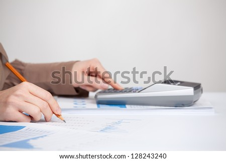 Business analysis - calculator, sheet, graph, (business report) and analyst woman. Selective focused on pencil.
