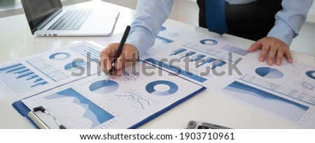Business analyst checking in financial statement for audit internal control system. Accounting and Financial Concept.