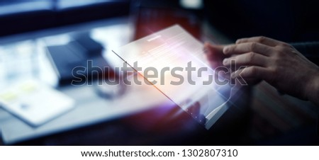 Business analyst is reading fresh financial report on a screen of modern hi tech digital tablet. Male hands with futuristic gadget #1302807310